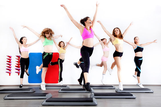 Women Doing Aerobic Exercise on Steppers