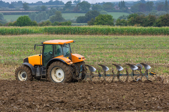 Agriculture - Tractor and Plow in a Field