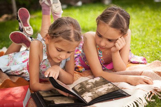 Children Perusing a Photo Album