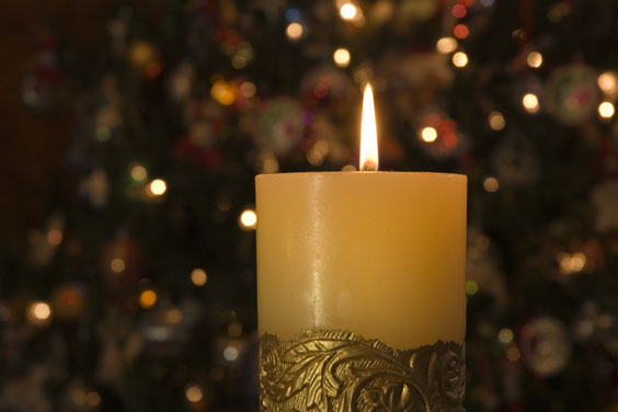 A Candle and Lights Provide Holiday Ambiance