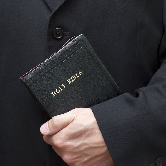 Christian Holding a Holy Bible
