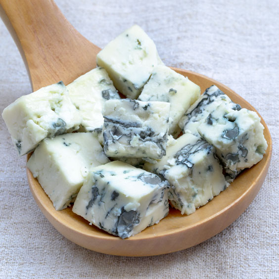Blue Cheese Squares on a Wooden Spoon