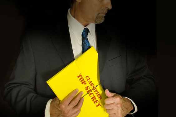 Man Holding a Classified, Top Secret File