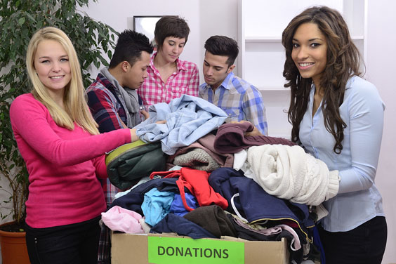 Volunteers with Clothing Donations