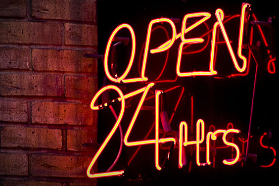 'Open 24 Hours' Sign on a Convenience Store