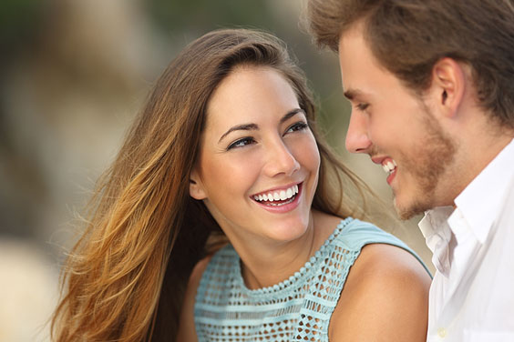 Smiling Couple against a Blurred Background