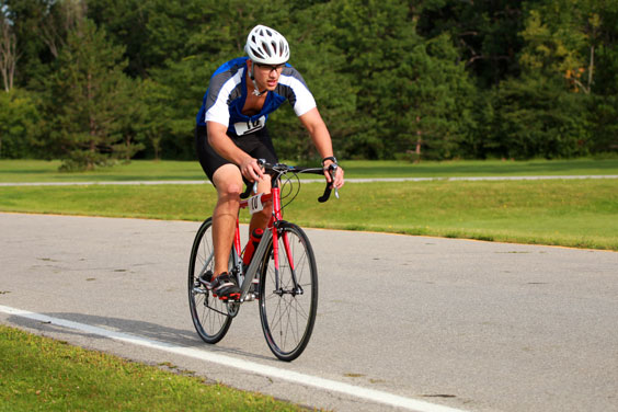 Triathlete Cycling on a Road Bike