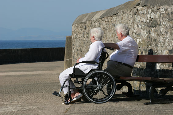 Disabled Elderly Woman Gazing at the Sea