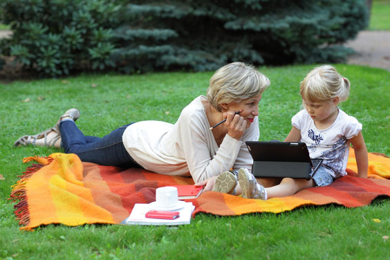 Young Child using a Tablet Outdoors