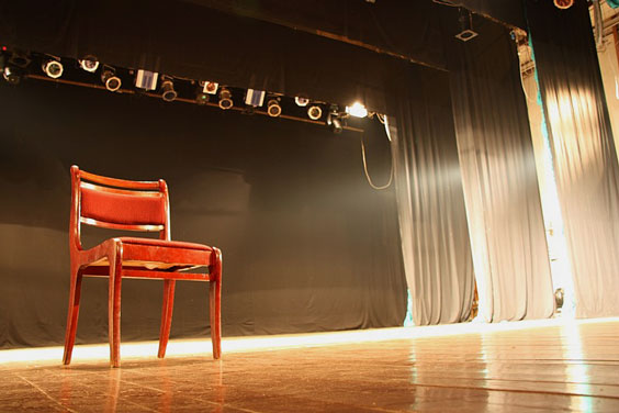 Empty Chair on an Empty Stage