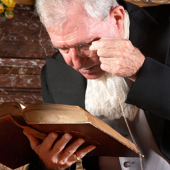 Elderly Gentleman Reading with an Eyeglass
