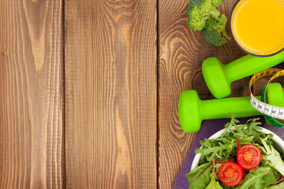 Dumbbells, Healthy Food, and Measuring Tape