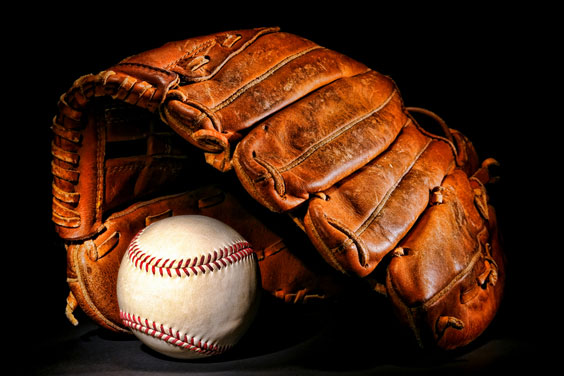 Baseball Glove and Ball on a Black Background
