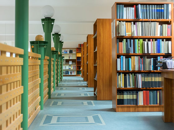 Green Lampposts in a Library