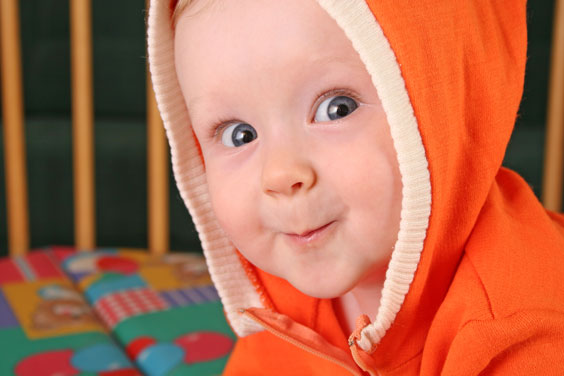 Orange Hood on a Smiling Baby