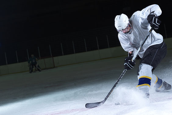 Ice Hockey Player with Stick and Puck