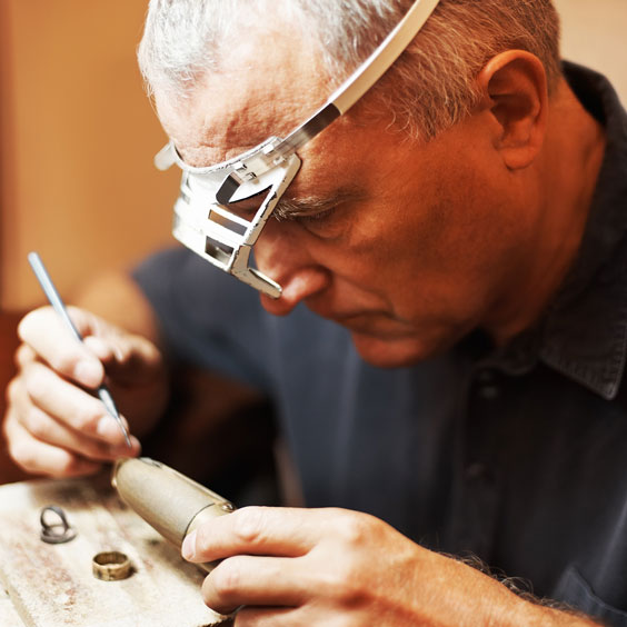 Jeweler, Wearing a Loupe, Making a Ring