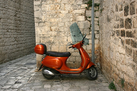 Motor Scooter in a Cobblestone Alleyway