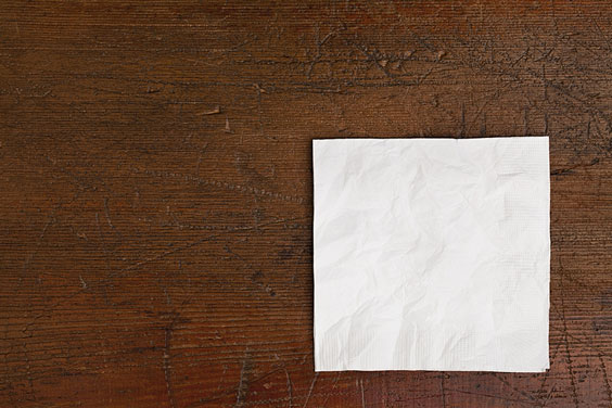 White Napkin on an Old Wooden Table