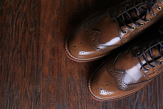 Pair of Brown Shoes on a Wood Background