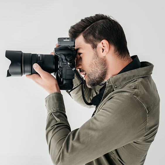Professional Photographer with DSLR Camera