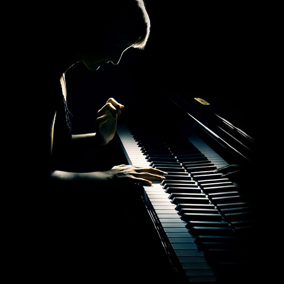 Silhouetted Pianist Playing a Piano