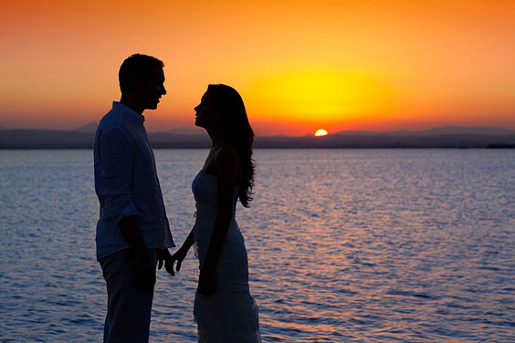 Loving Relationship Silhouetted Against a Sunset