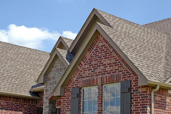 Asphalt Roof Shingles on a Brick House