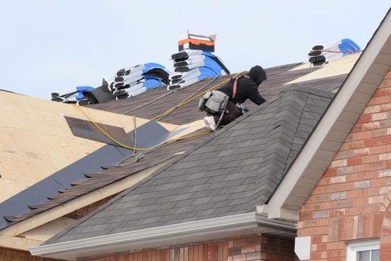 Roofer Installing Asphalt Shingles