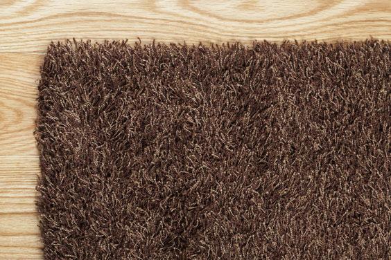 Brown Rug on a Hardwood Floor