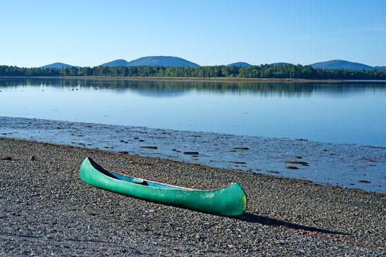 Canoe on a Lake Shore