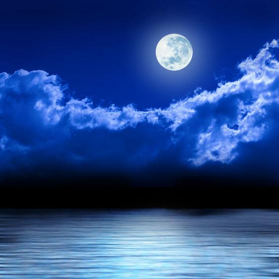Full Moon in a Night Sky over a Calm Ocean