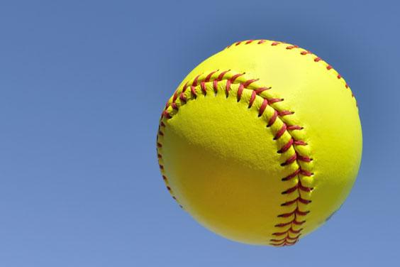Yellow Softball against a Blue Sky