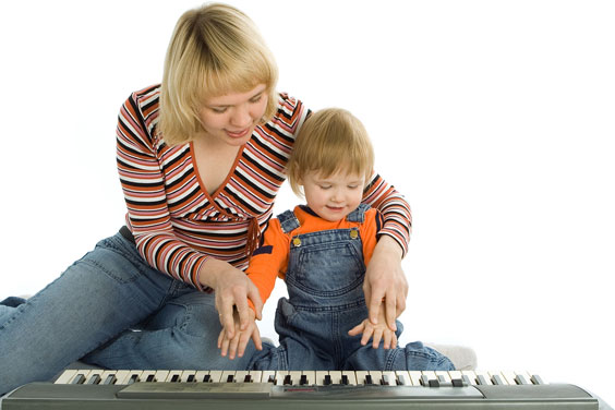 Mother Teaching her Son to Play a Piano