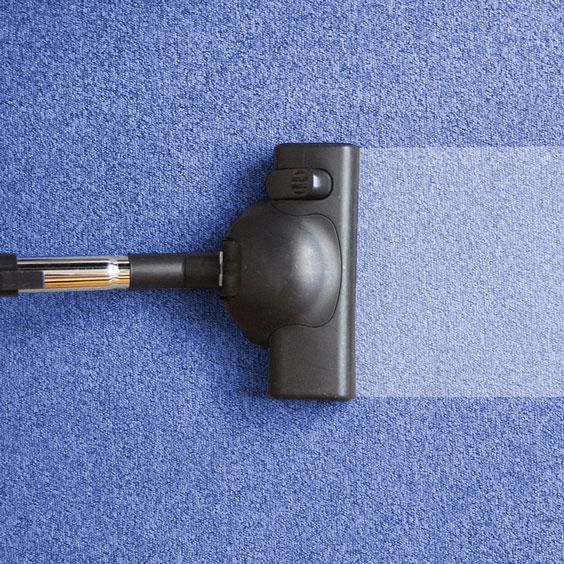 Vacuum Cleaner Vacuuming Dirt from a Carpet