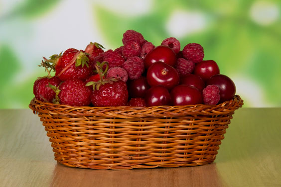 Wicker Basket Filled with Berries and Cherries